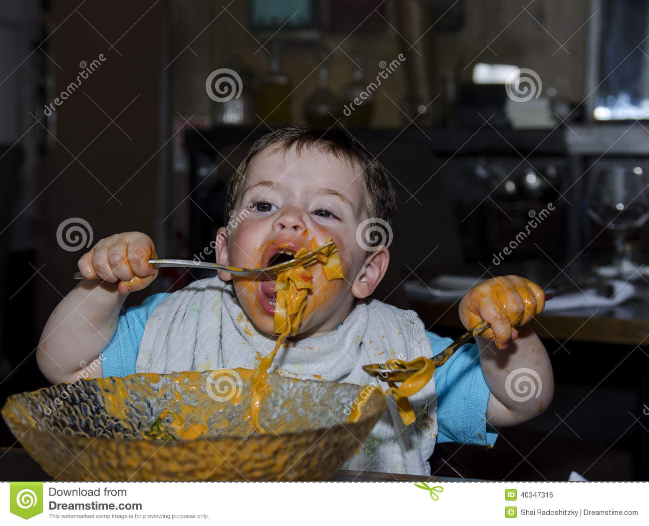 Toddler covered with pasta