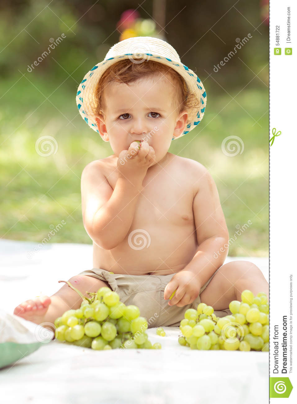 Toddler eating grapes