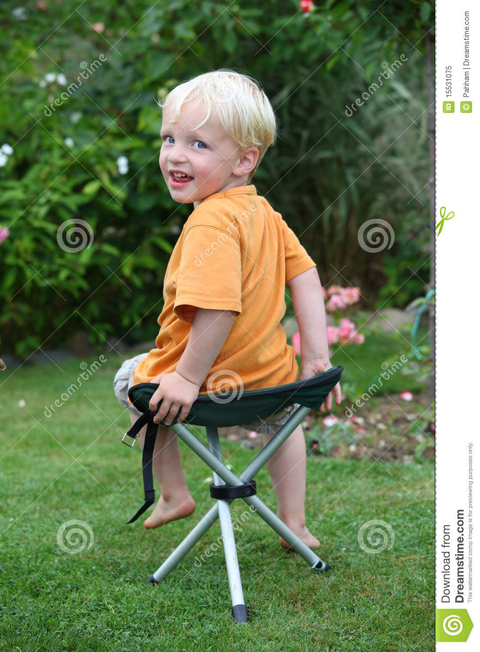 Toddler on a folding chair royalty free stock photo for Toddler sitting chair
