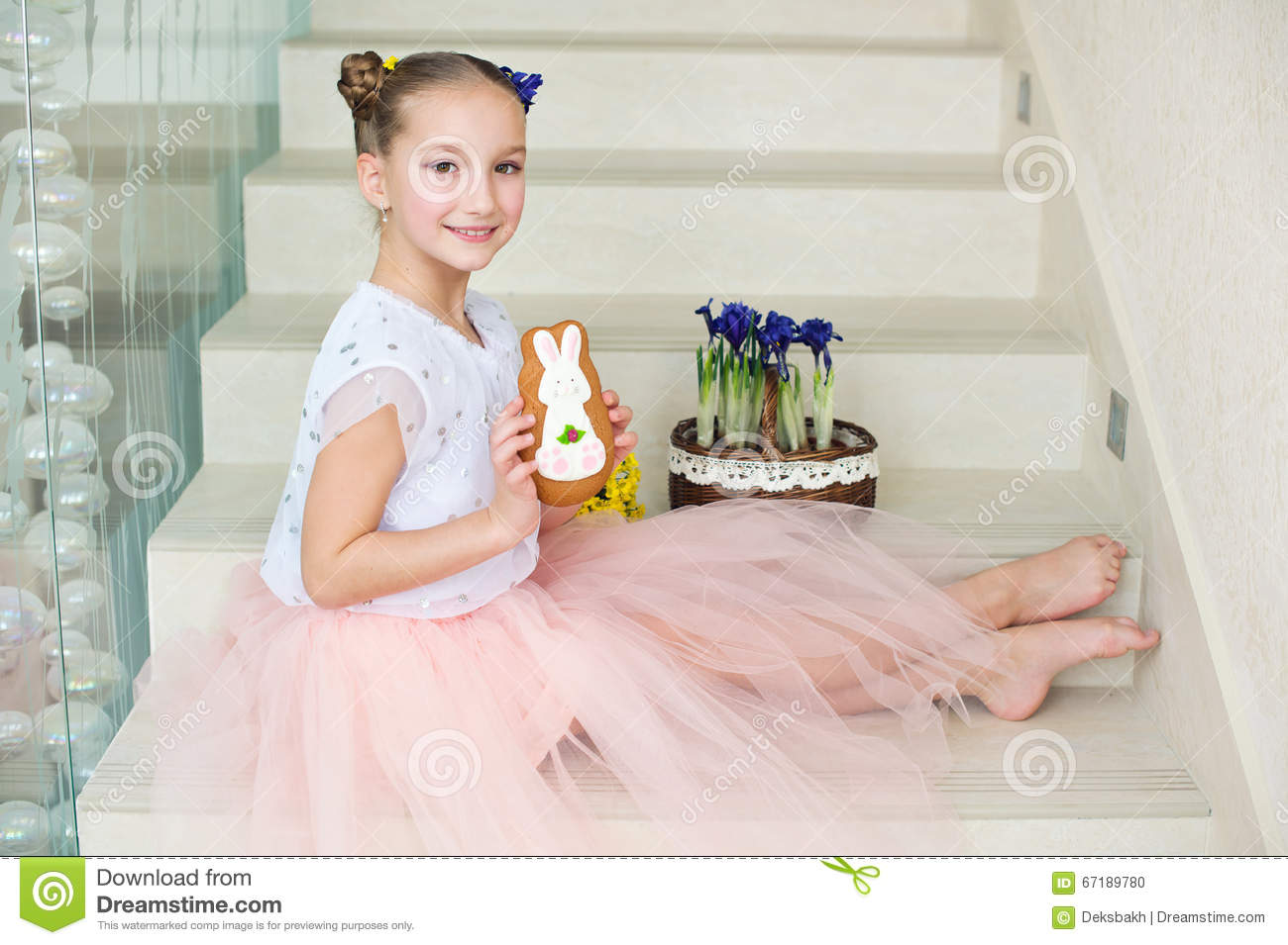 Toddler funny ballerina girl at home ready to celebrate spring a