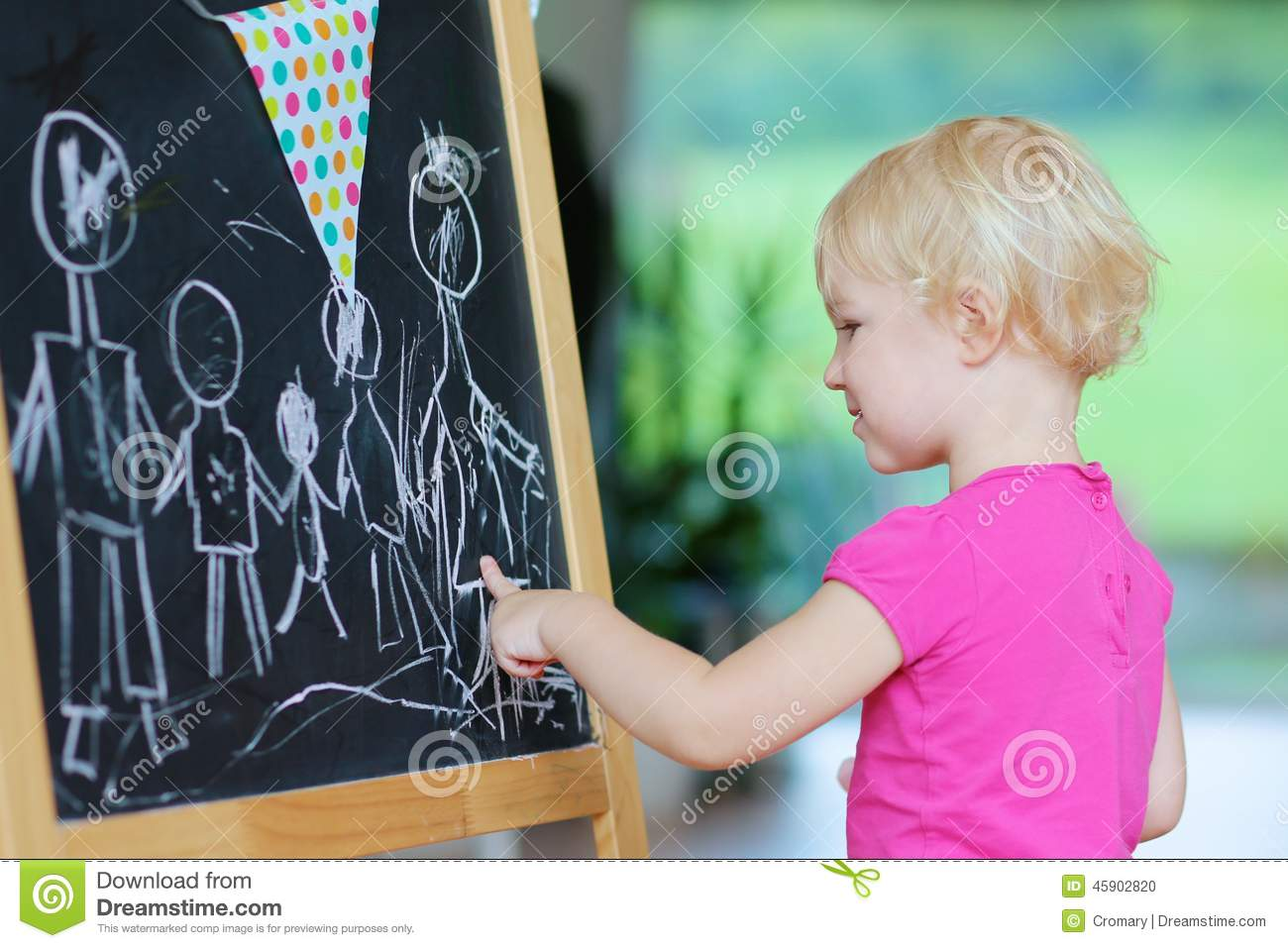 Preschooler girl drawing on black board royalty free stock for The drawing board
