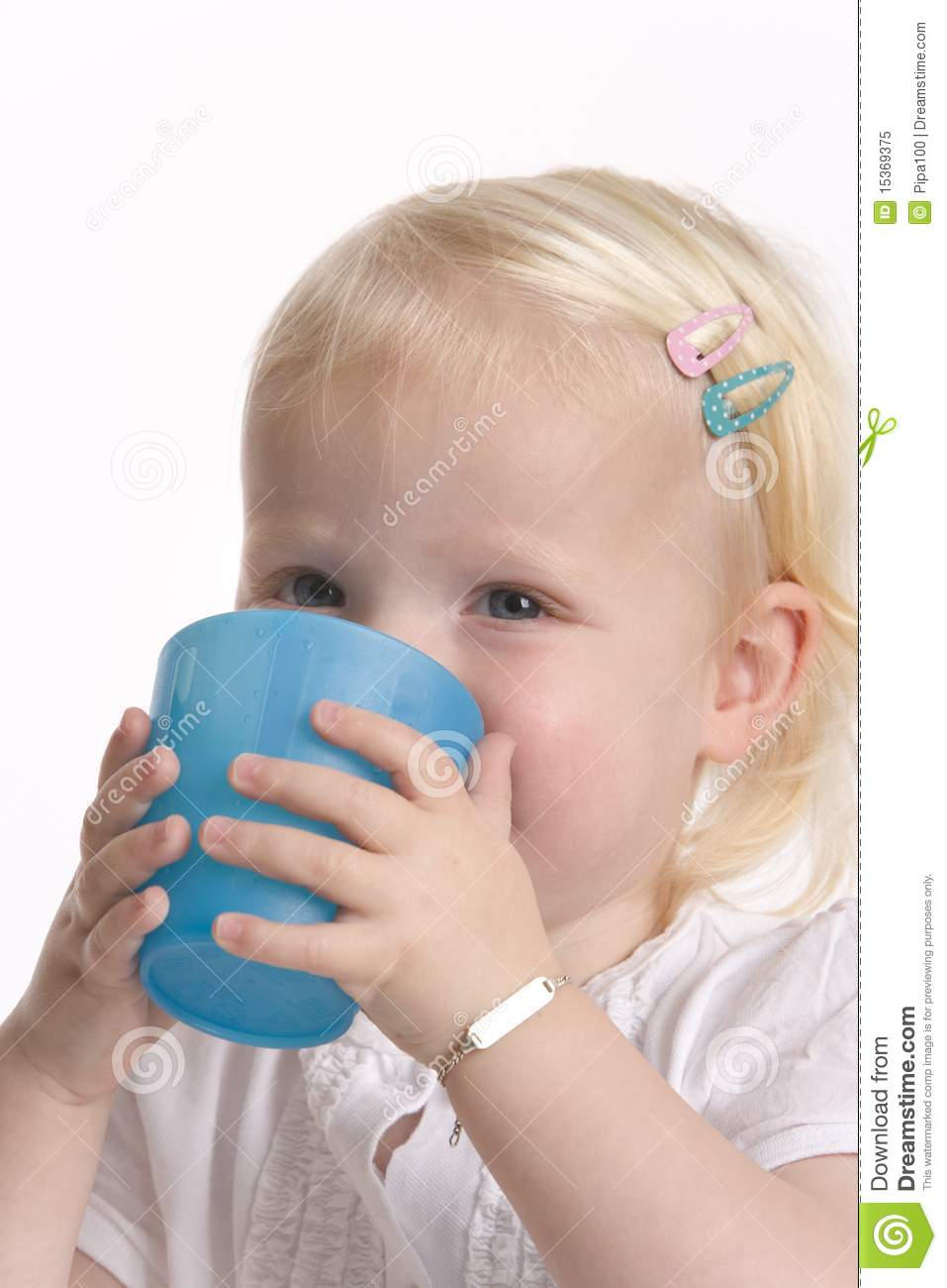 Toddler Girl Drinking From Cup Royalty Free Stock Photo