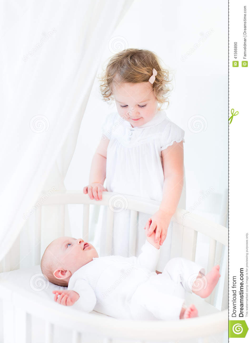 Toddler Girl Holding Hands With Newborn Brother Stock ...