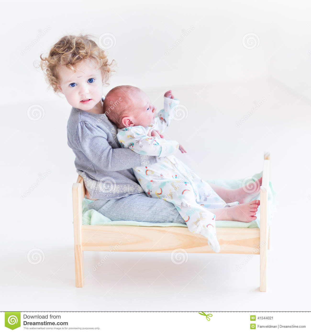 toddler girl with newborn baby brother in toy bed stock image image 41544021. Black Bedroom Furniture Sets. Home Design Ideas
