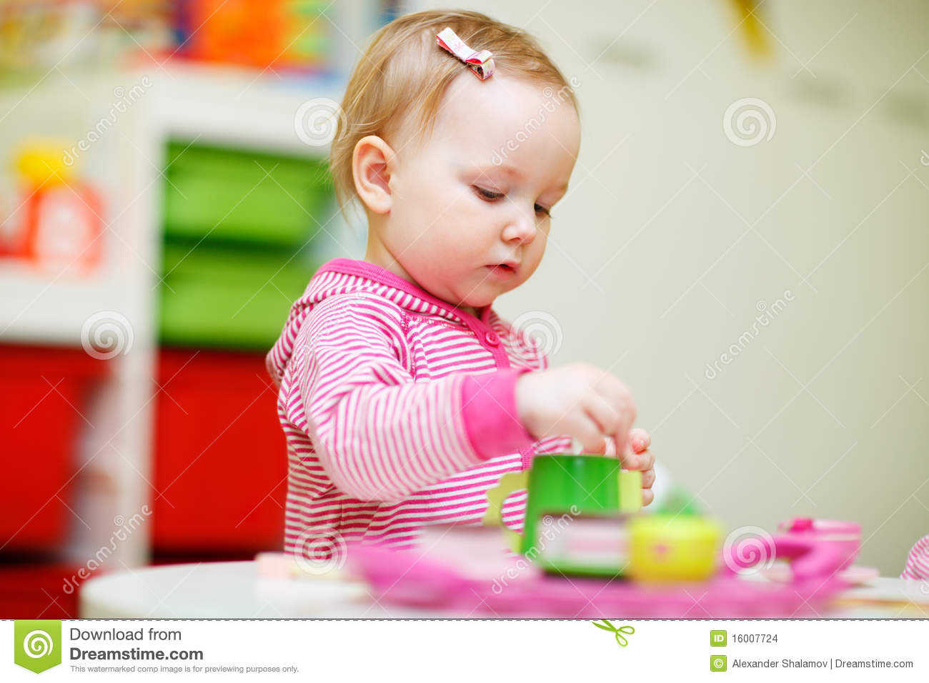 Day Care Toys For Toddler : Toddler girl playing with toys stock images image