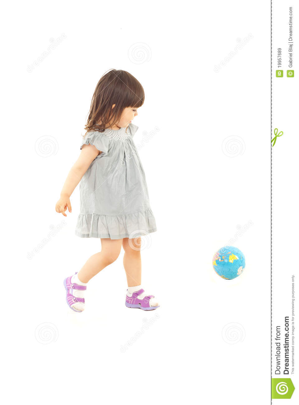 Toddler girl playing with world globe