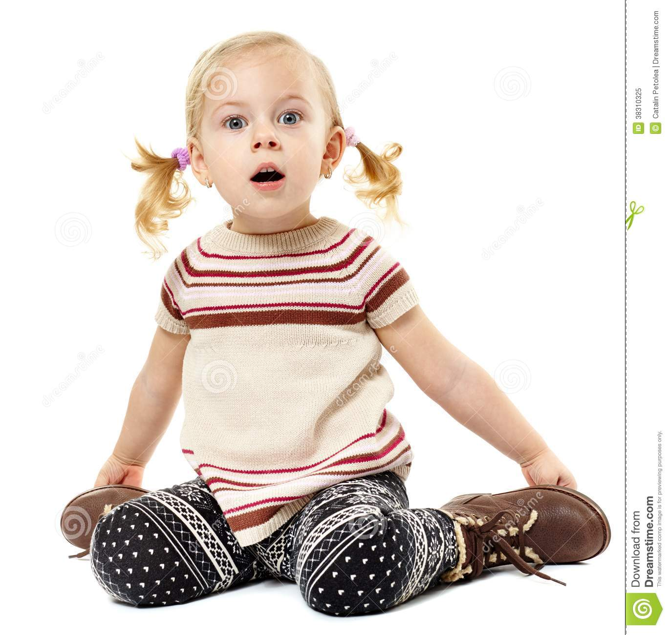 Toddler girl sitting on the floor and expressing surprise royalty free