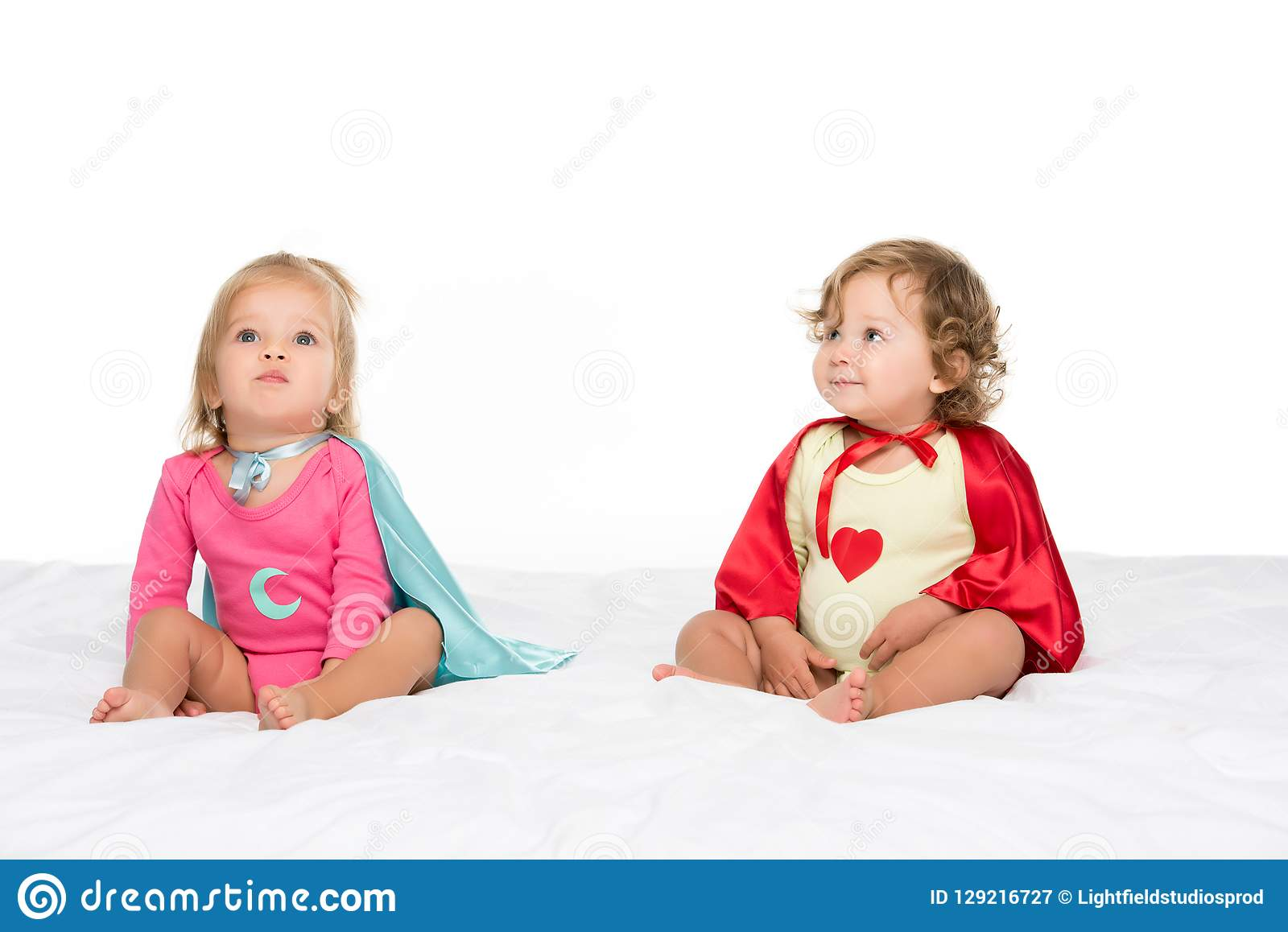 toddler girls in superhero capes