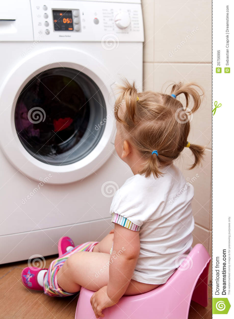 Toddler near clothes dryer