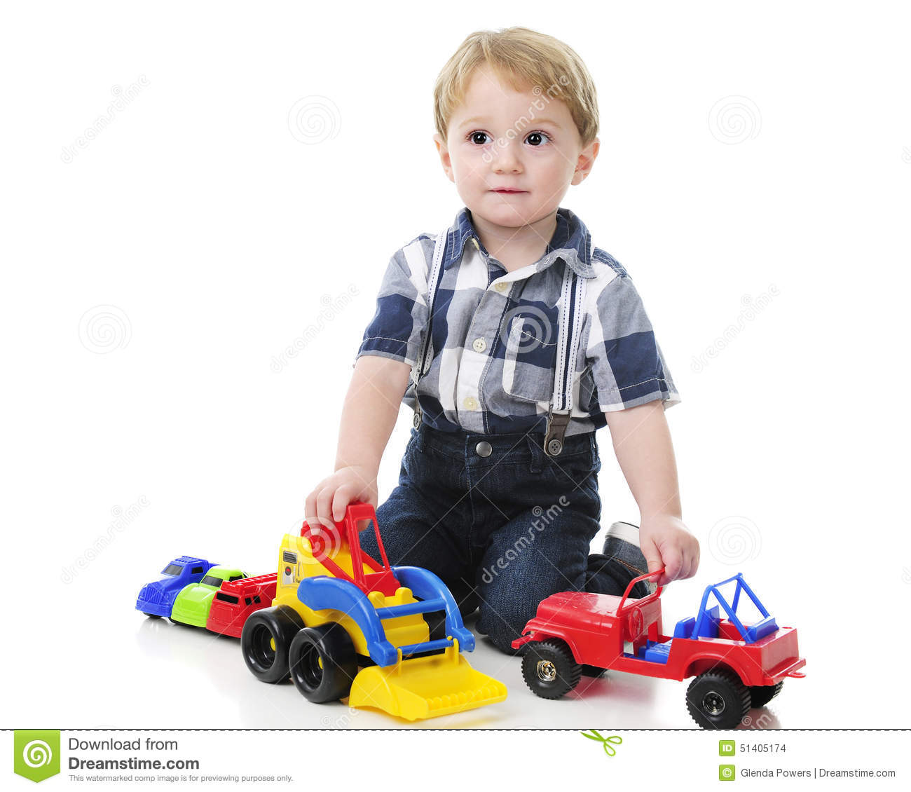 Toddler Playing Cars And Trucks Stock Photo