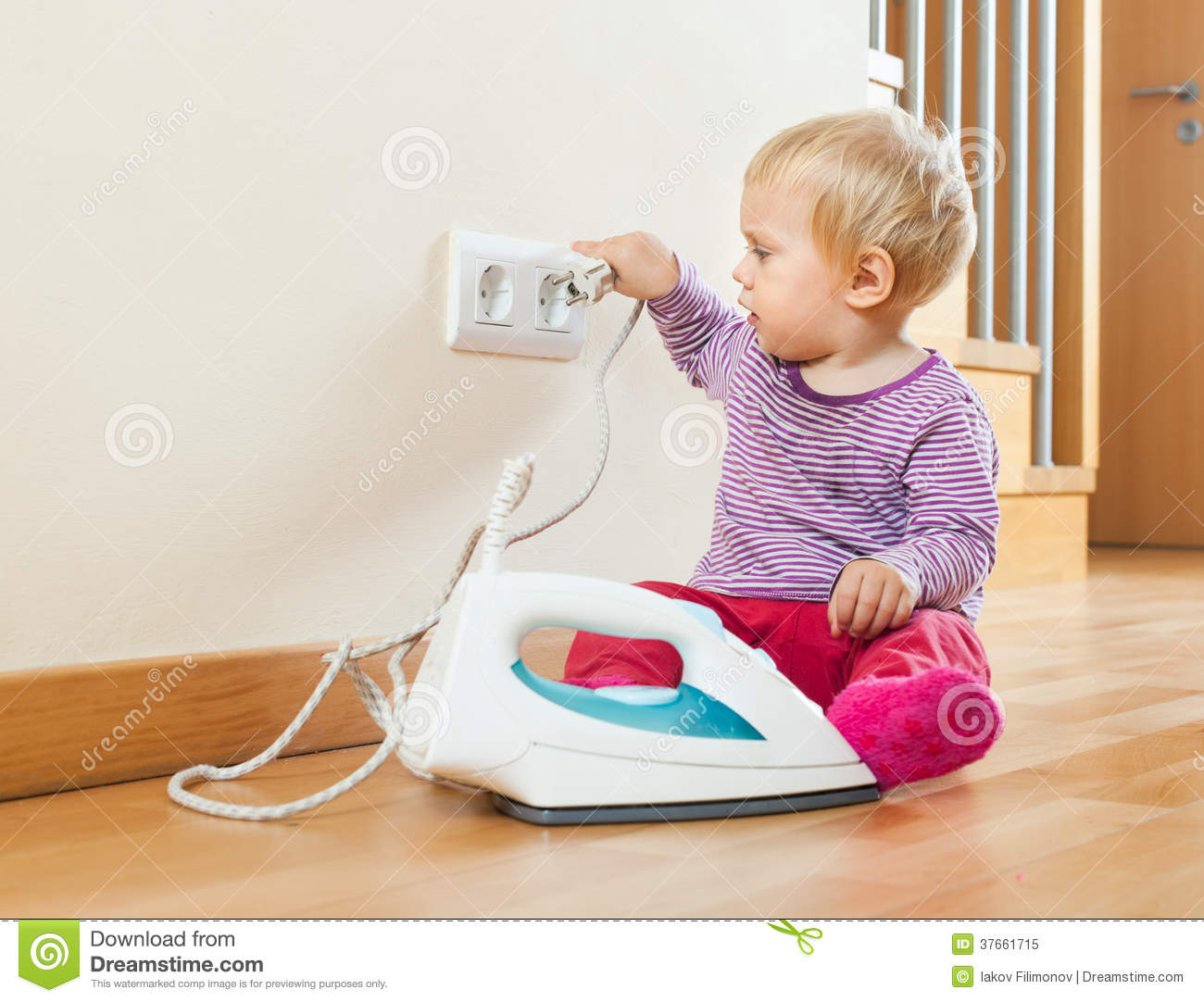 Toddler Playing With Electric Iron Royalty Free Stock
