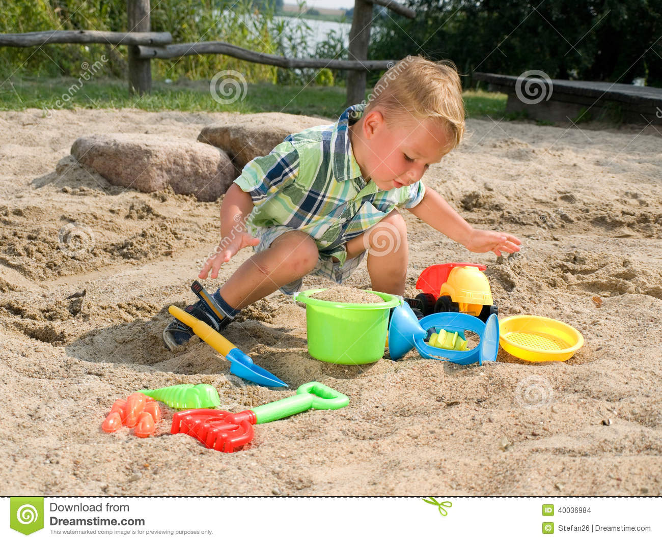 Lake Toys For Boys : Toddler with sand toys stock photo image