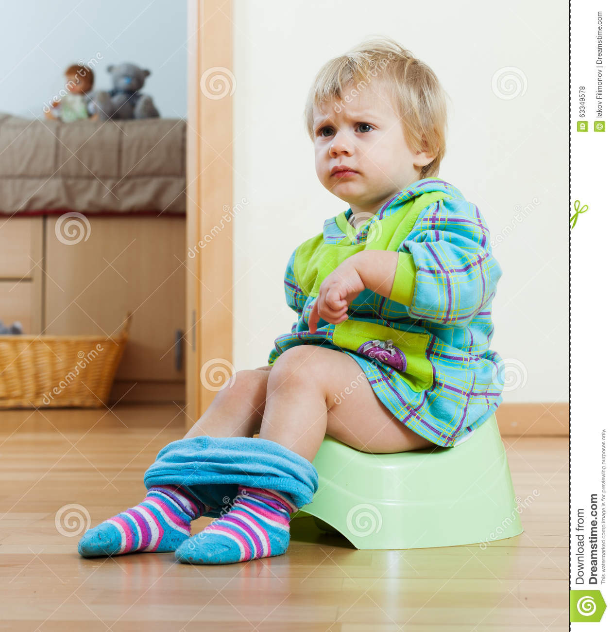 Little Sad Boy Is Sitting On The Chair Along Stock Image