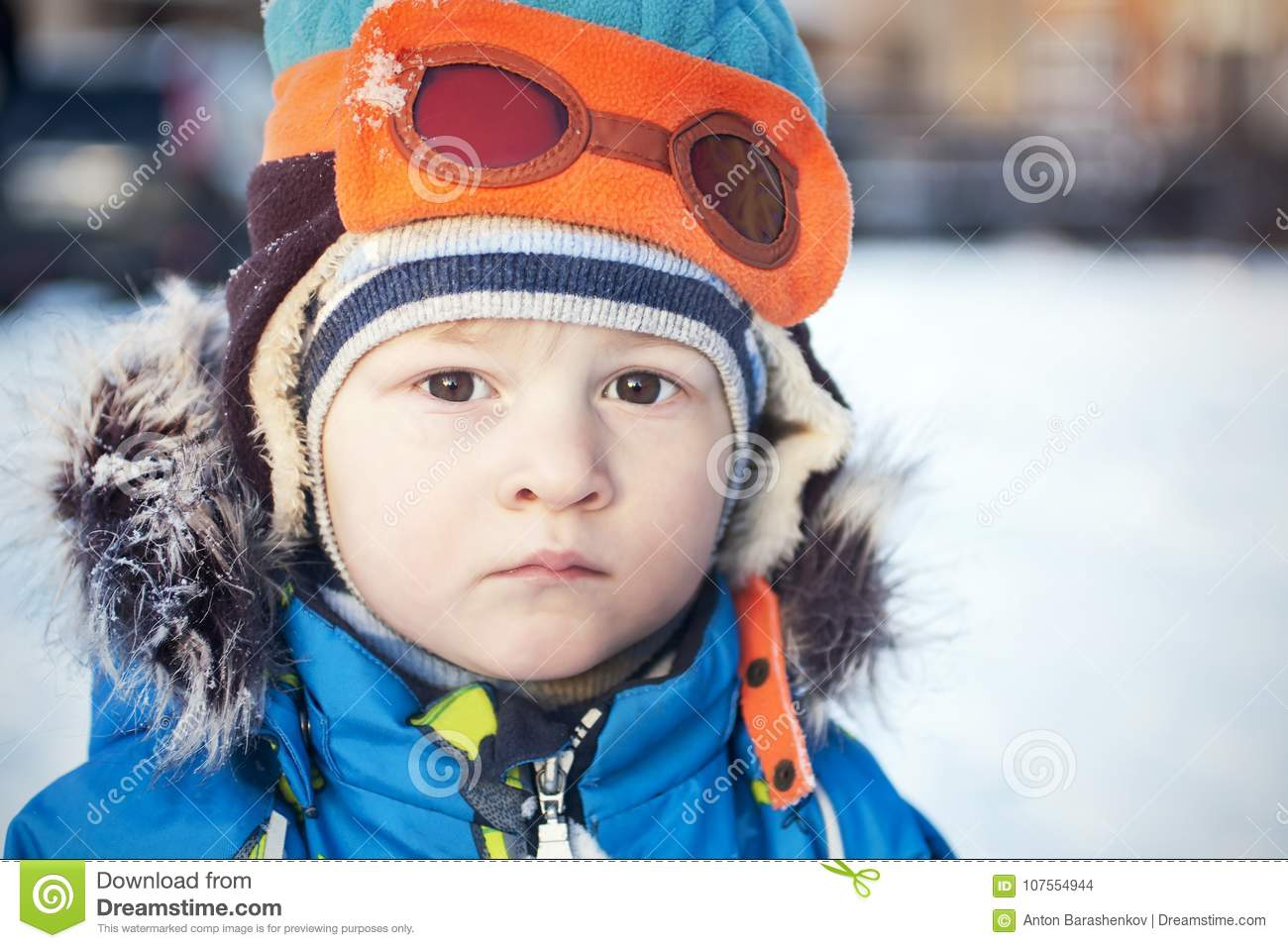 Toddler In Snow Winter In Fur Coat And Pilot Hat Stock Photo - Image ... 158f940ee58