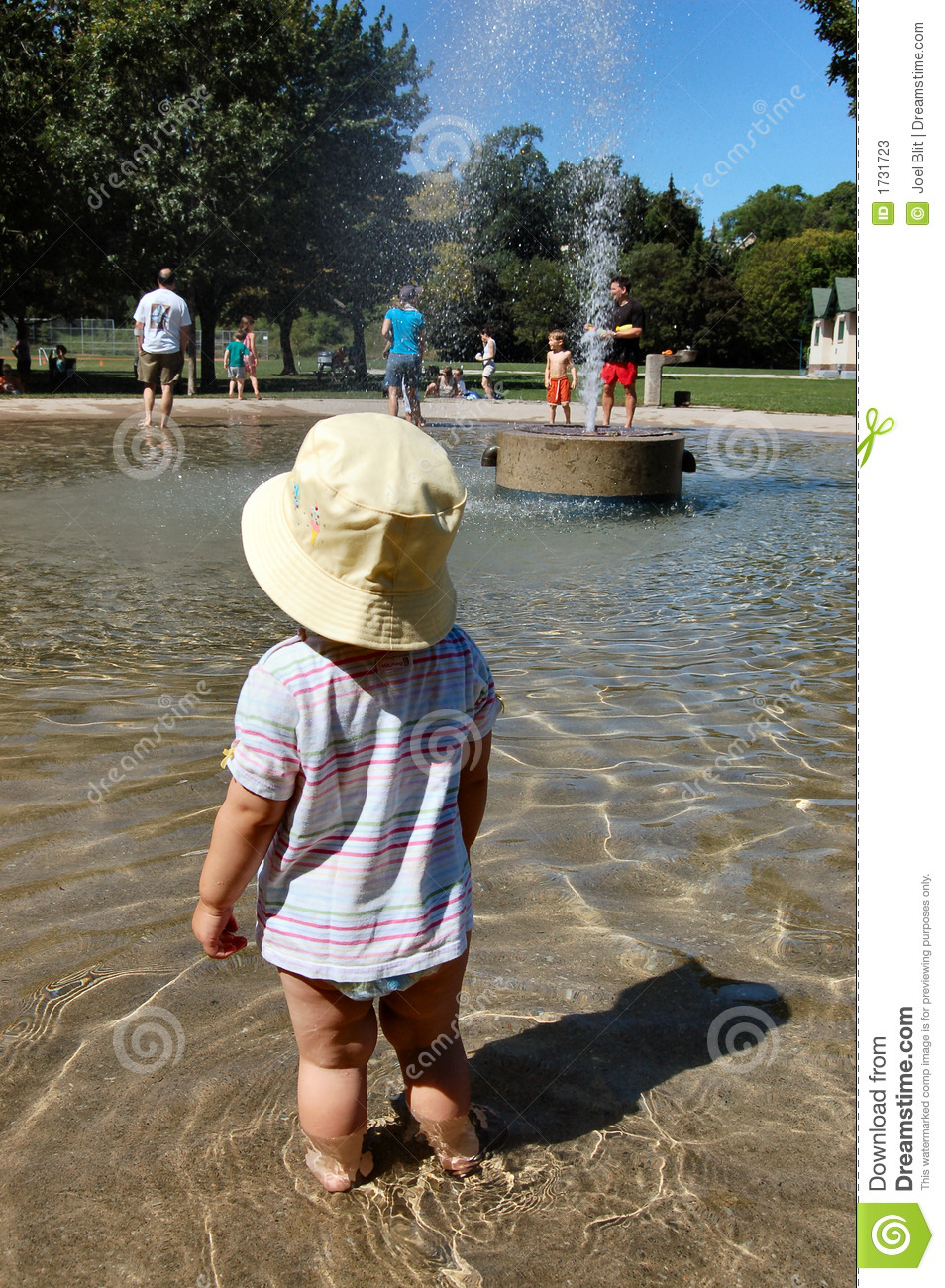 Toddler in wading pool