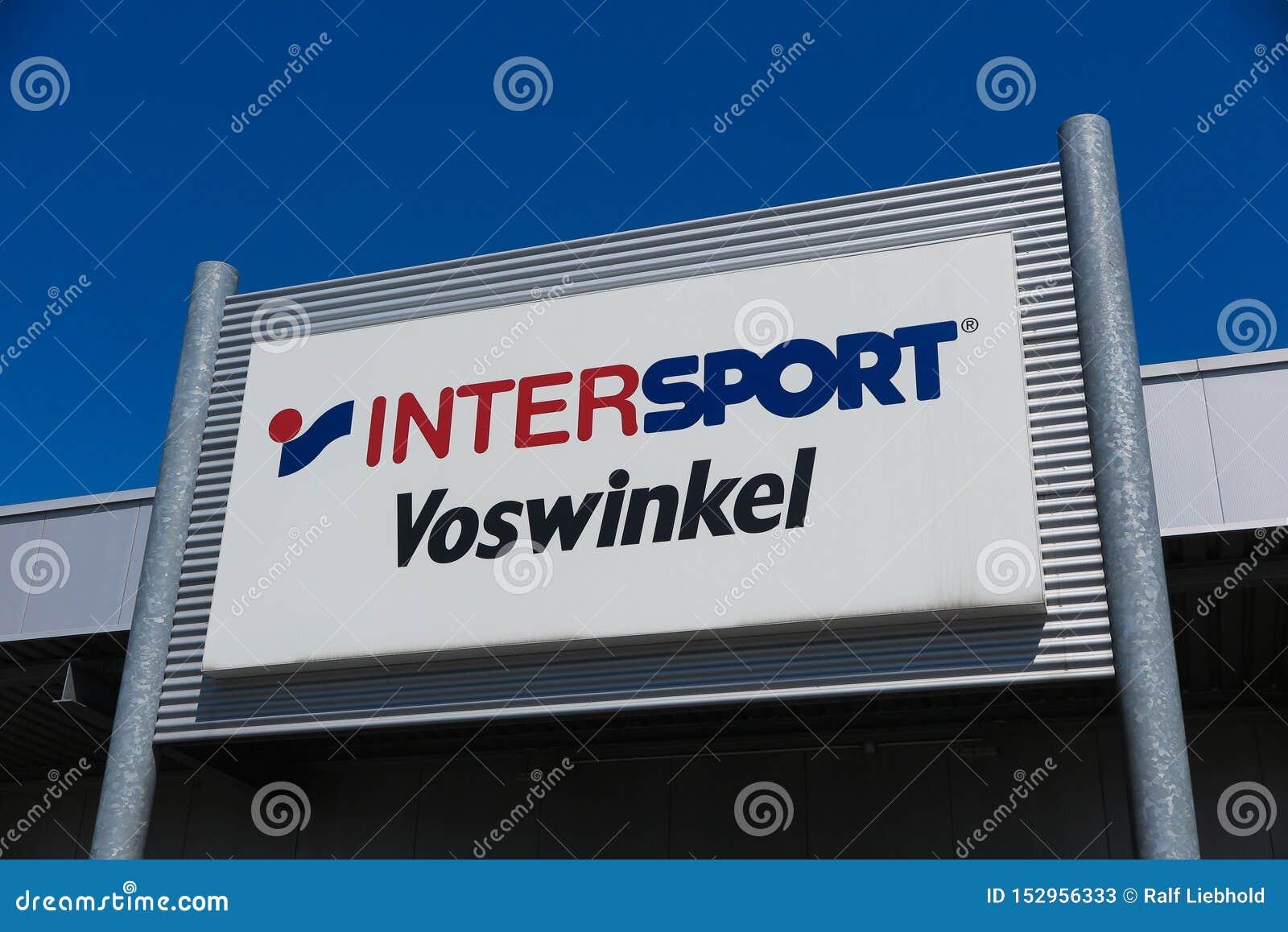 TOENISVORST, GERMANY - JUIN 28. 2019: Close up of logo against blue sky of Intersport Vosswinkel German chain for sports supplies