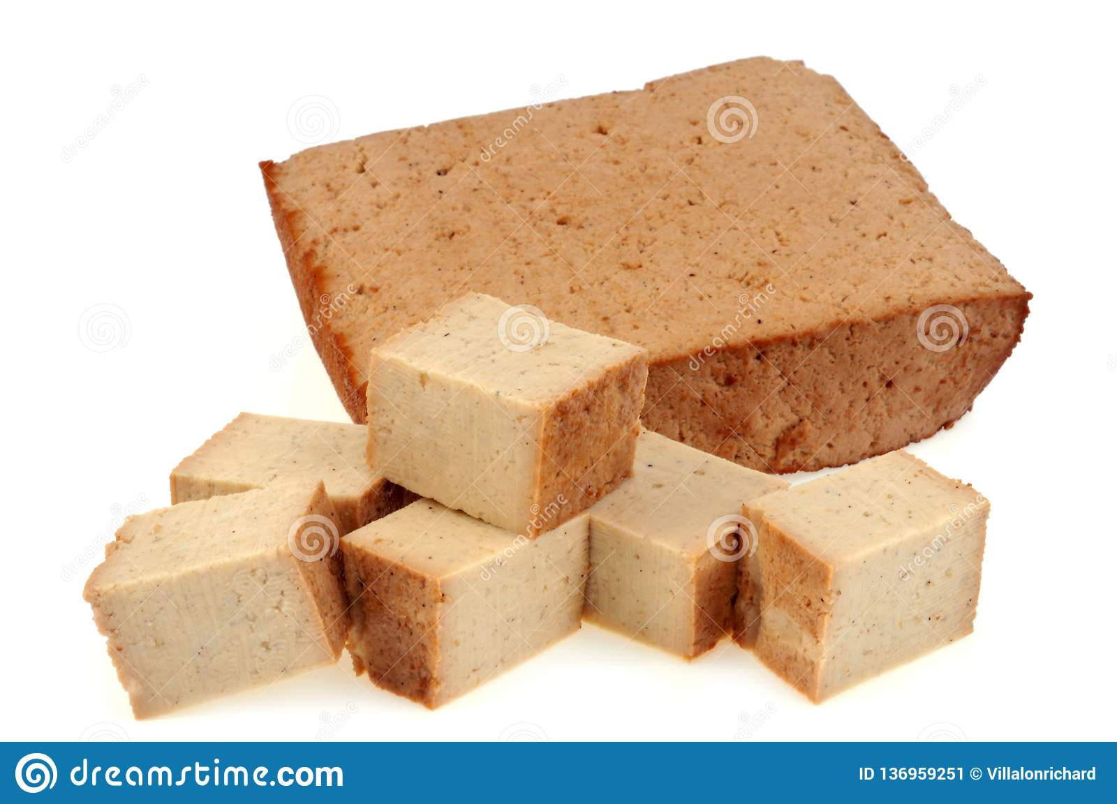 Tofu cut into pieces on white background