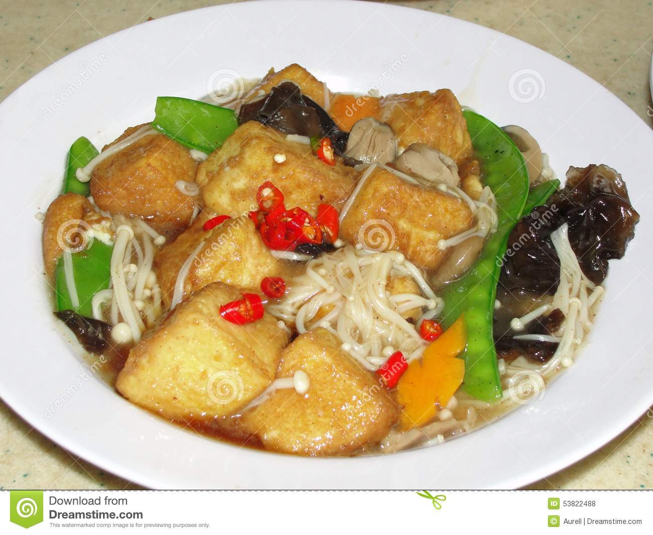 Fried tofu sautéed with black mushroom and vegetables in oyster chile ...