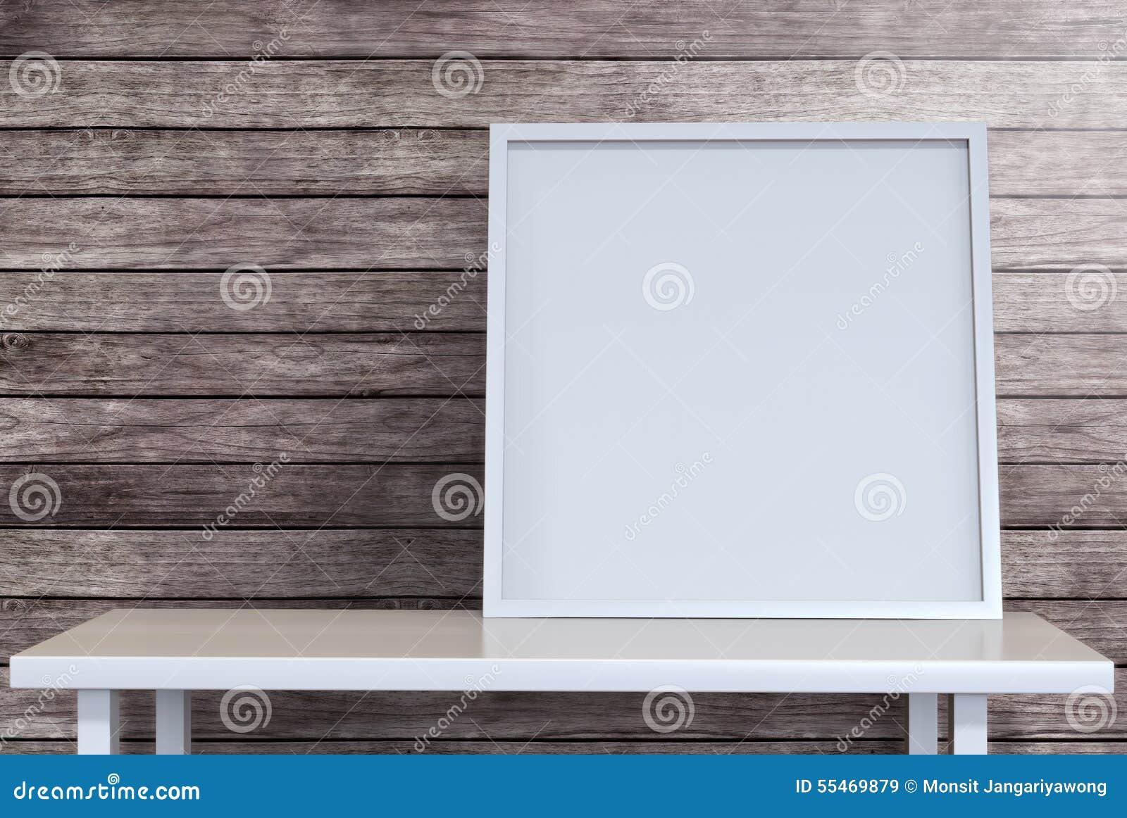 Toile vide de cadre de tableau sur le bureau dans la chambre de