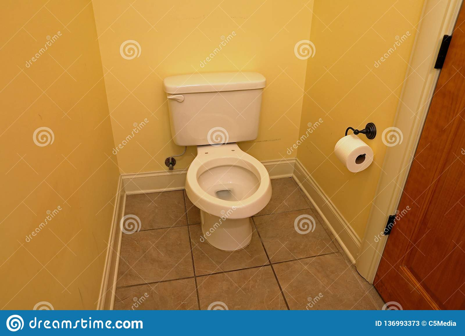 Toilet with seat removed. Toilet with no seat, in small home bathroom stock photos