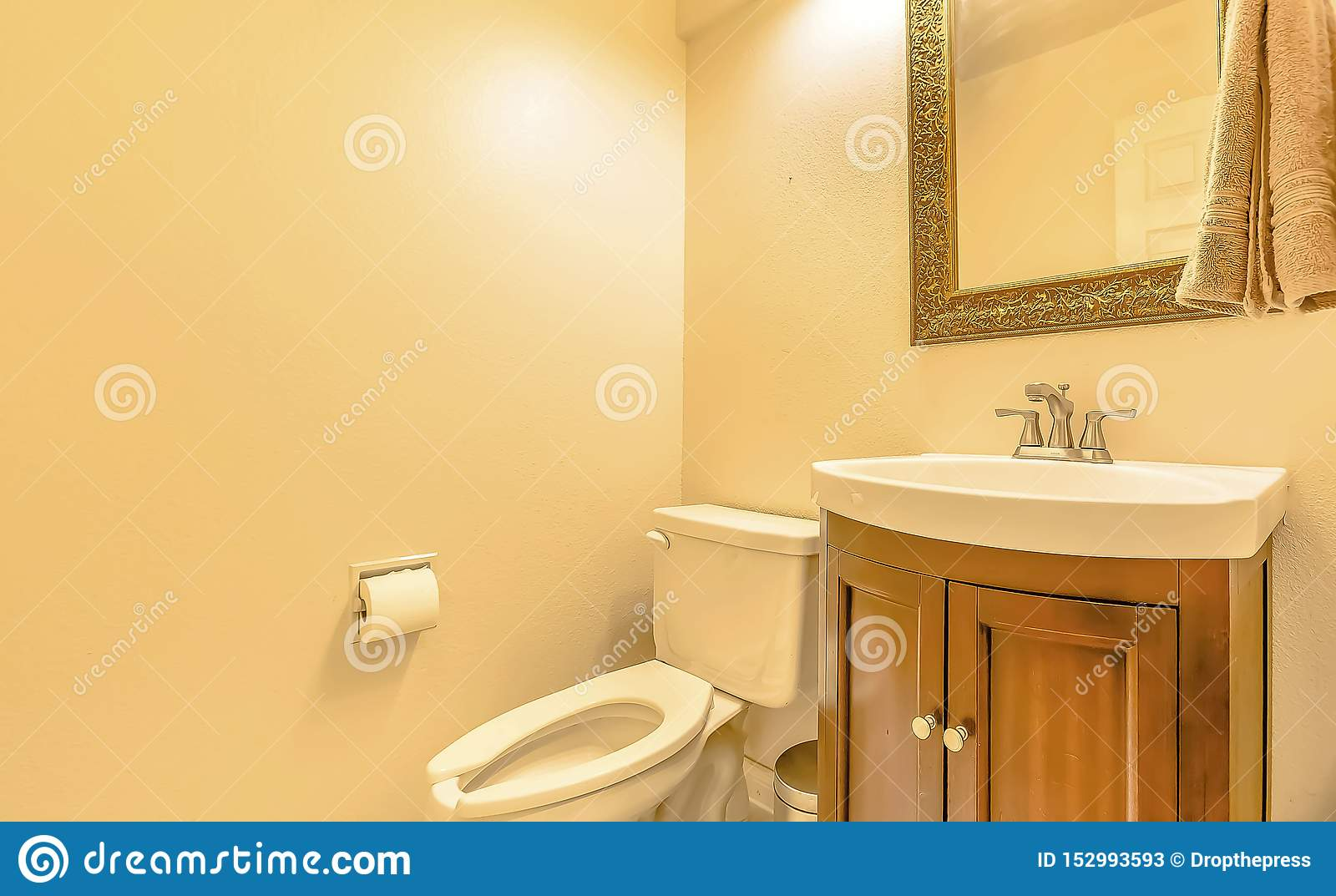 Picture of: Toilet And Sink Inside The Bathroom Of A House With Cream Colored Wall Stock Image Image Of Architectural Clean 152993593