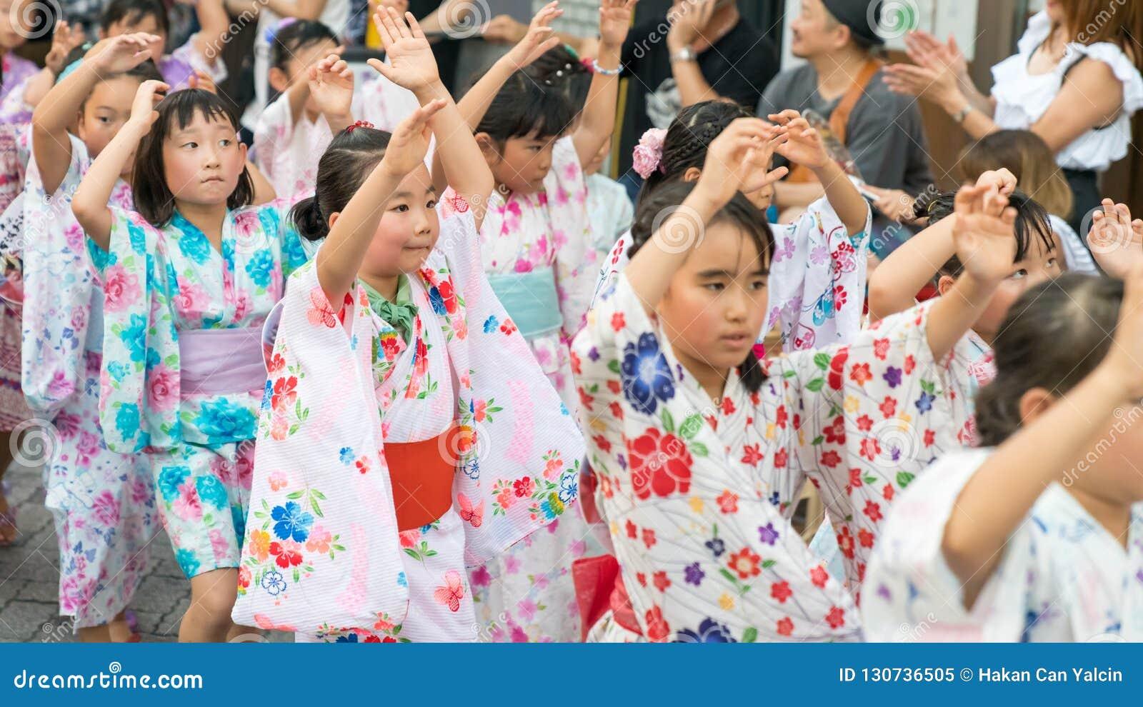 Japanese children dancing traditional Awaodori dance in the famous Koenji Awa Odori festival, Tokyo, Japan
