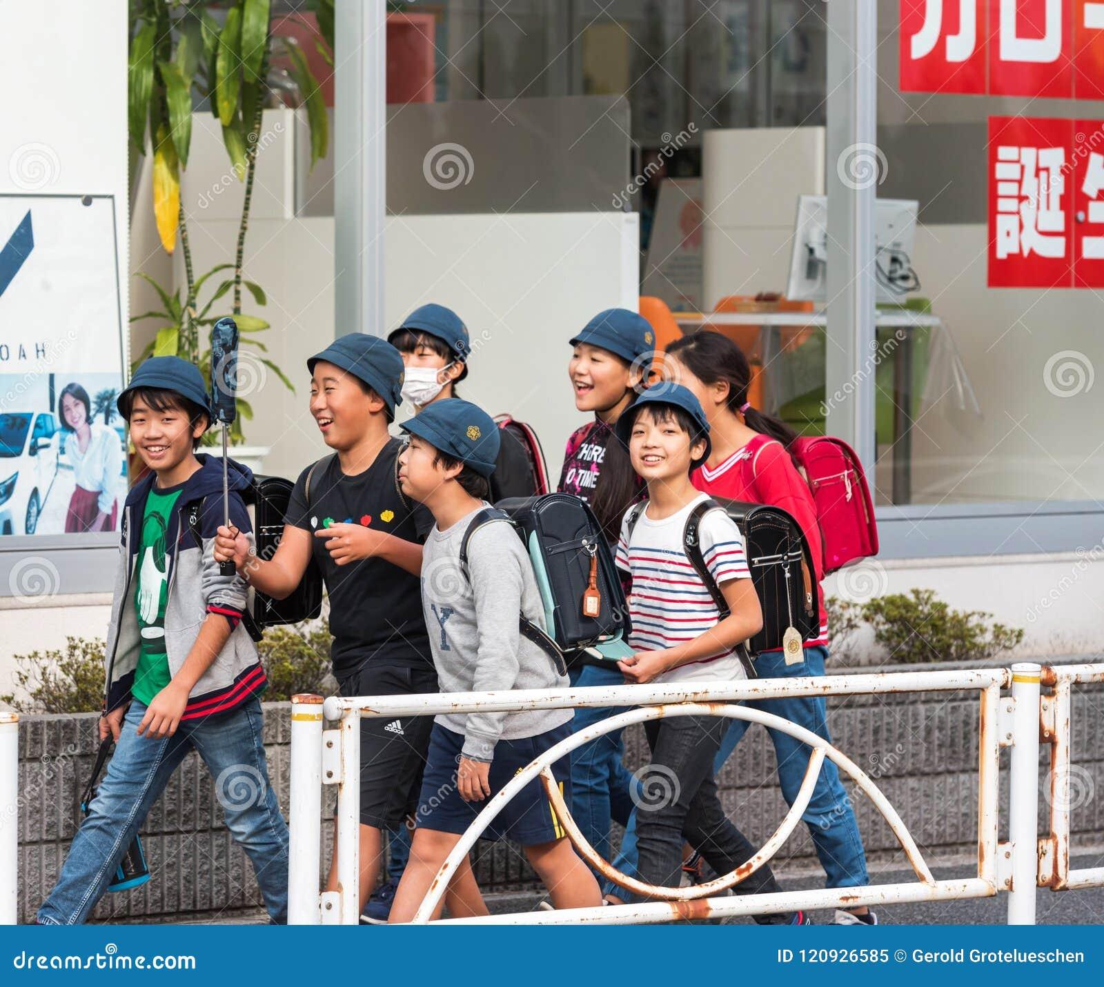TOKYO, JAPAN - NOVEMBER 7, 2017: Group of children on a city street.