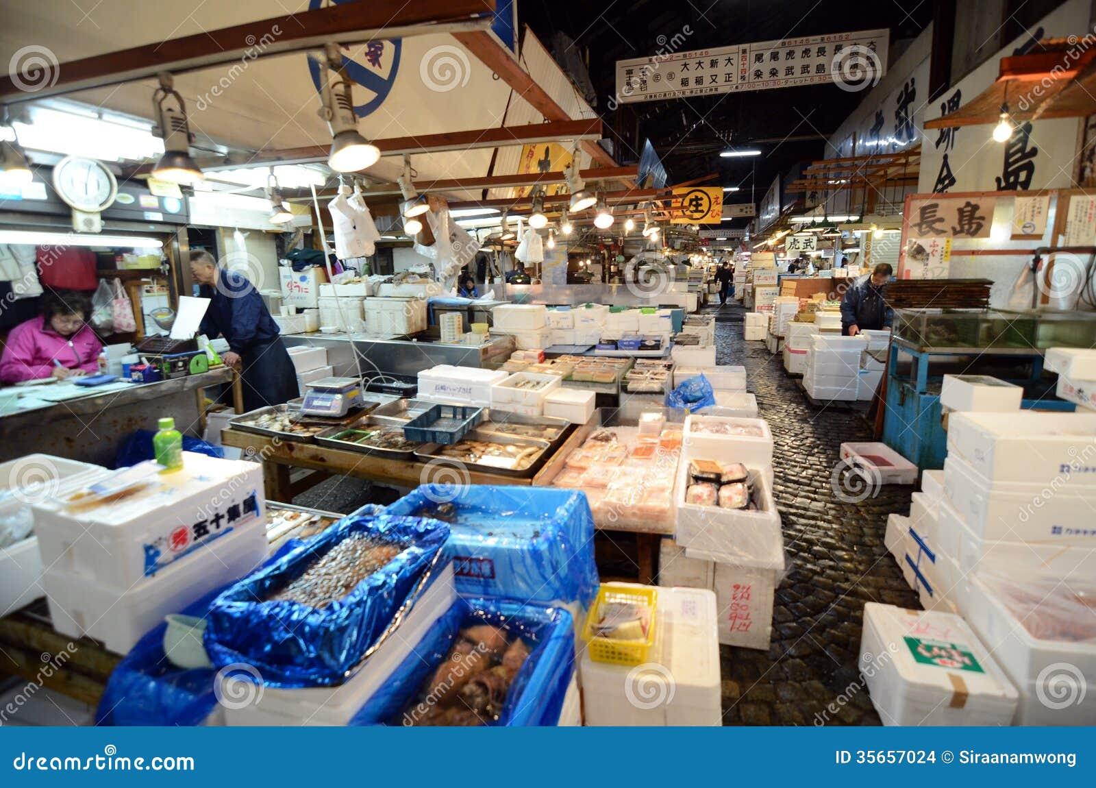Tokyo nov 26 seafood vendors at the tsukiji wholesale for Wholesale fish market