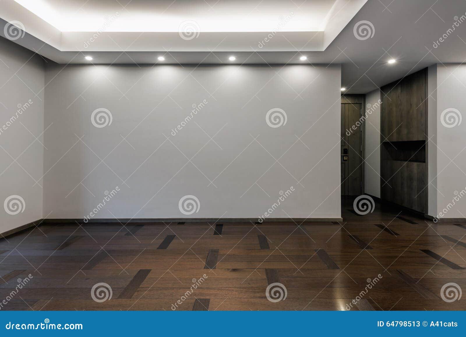 Tom vardagsrum i grå färgfärg arkivfoto   bild: 64798513