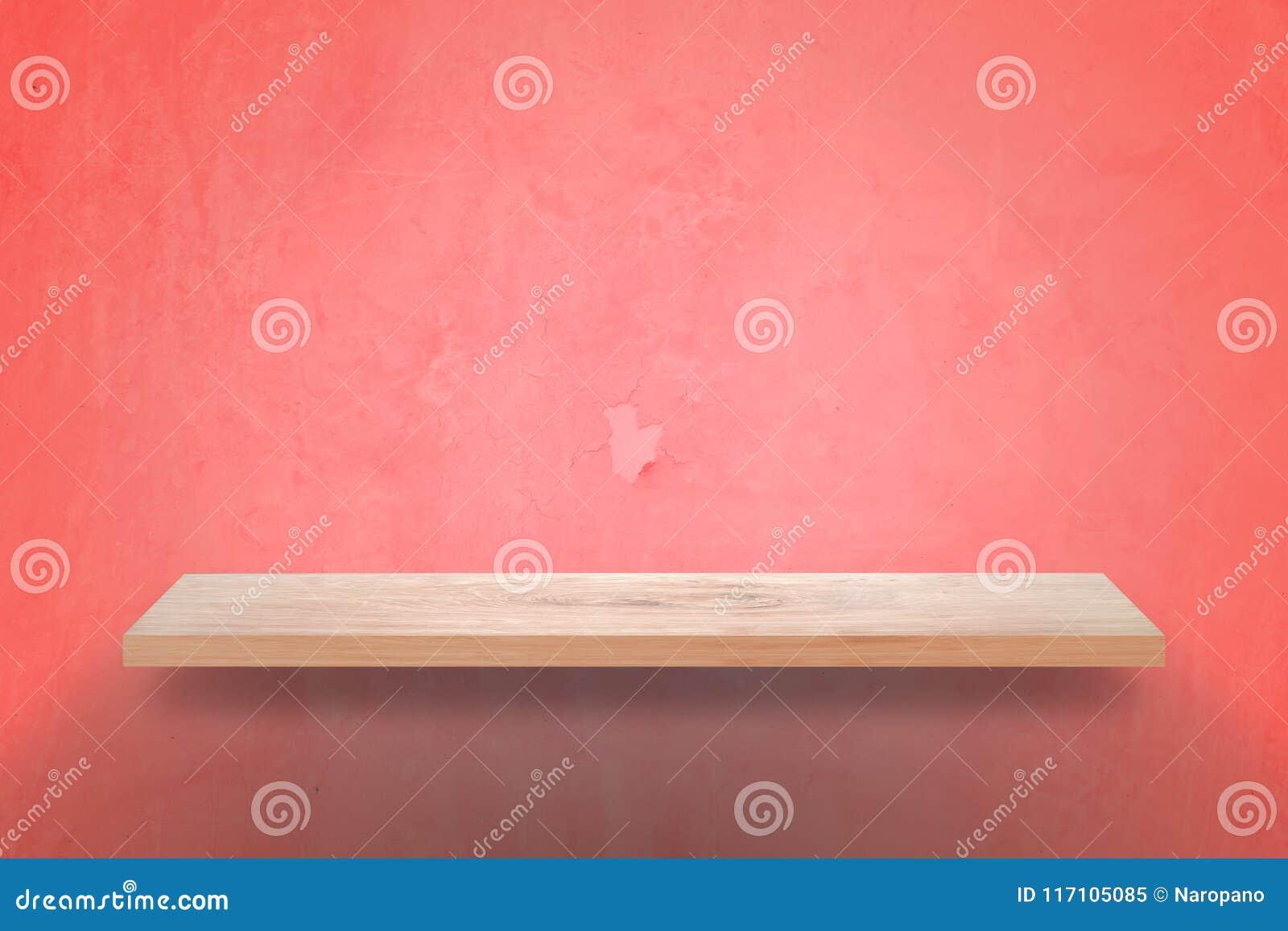 Tom wood hylla med rosa väggbakgrund för grunge