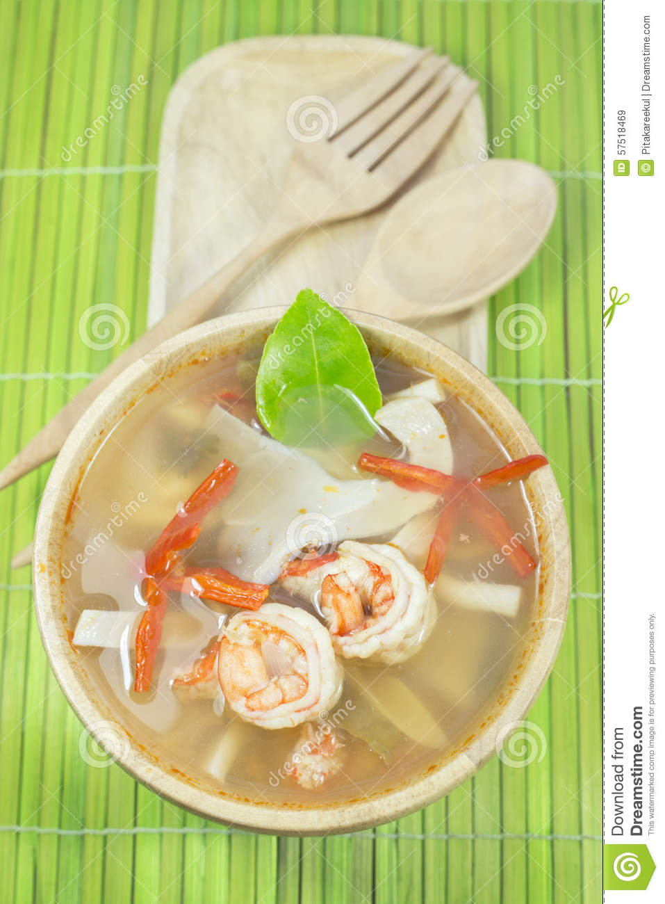 Tom yum goong homemade thai style food with wooden for Cuisine wooden