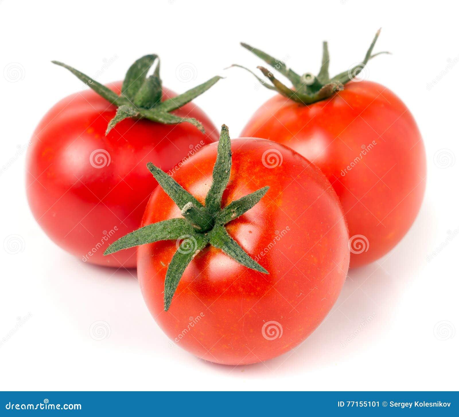 Tomate trois d isolement sur un fond blanc