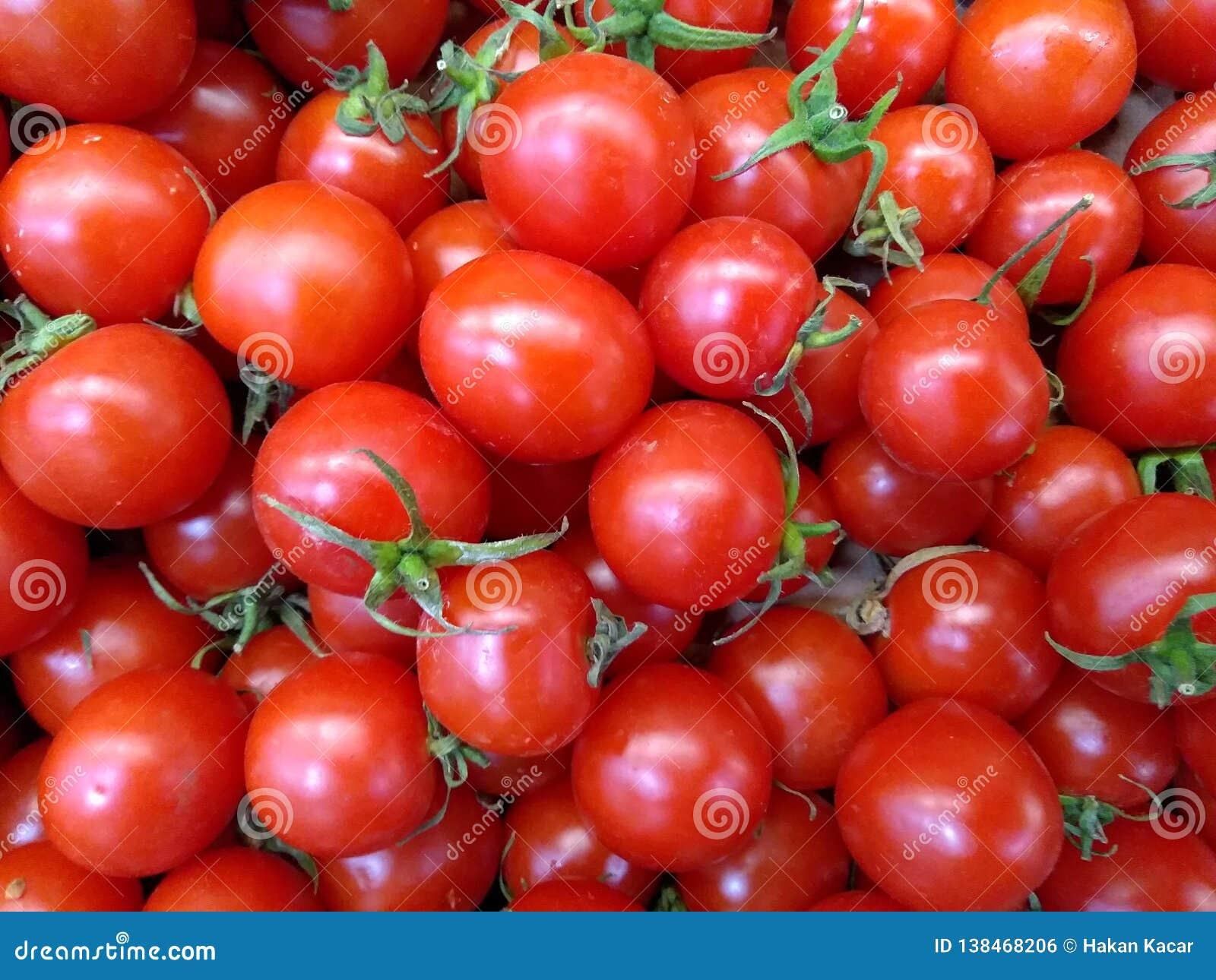 Tomater röd closeup för mat för tomatmatbakgrund