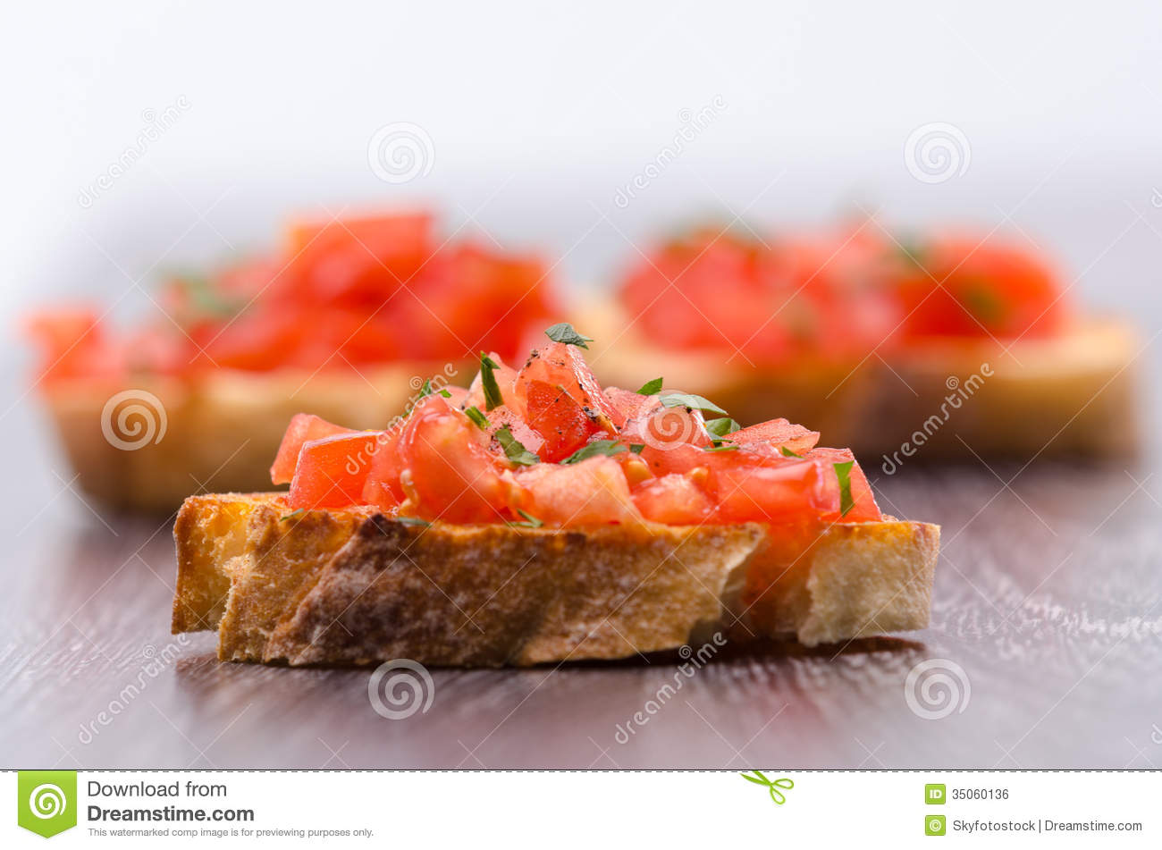 Tomato Bruschetta with olive oil, garlic and fresh basil leaves.