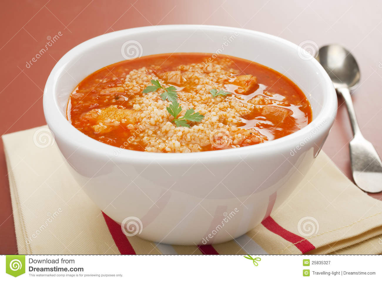 Moroccan soup, chicken with tomato and couscous, flavoured with cumin ...