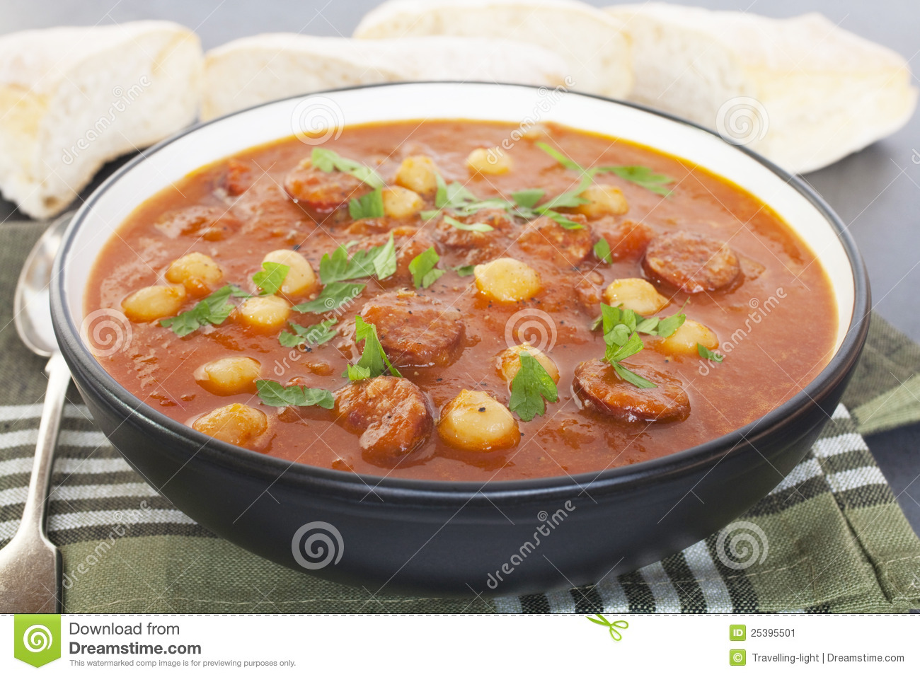Spanish tomato soup with chorizo and chickpeas, served with bread ...