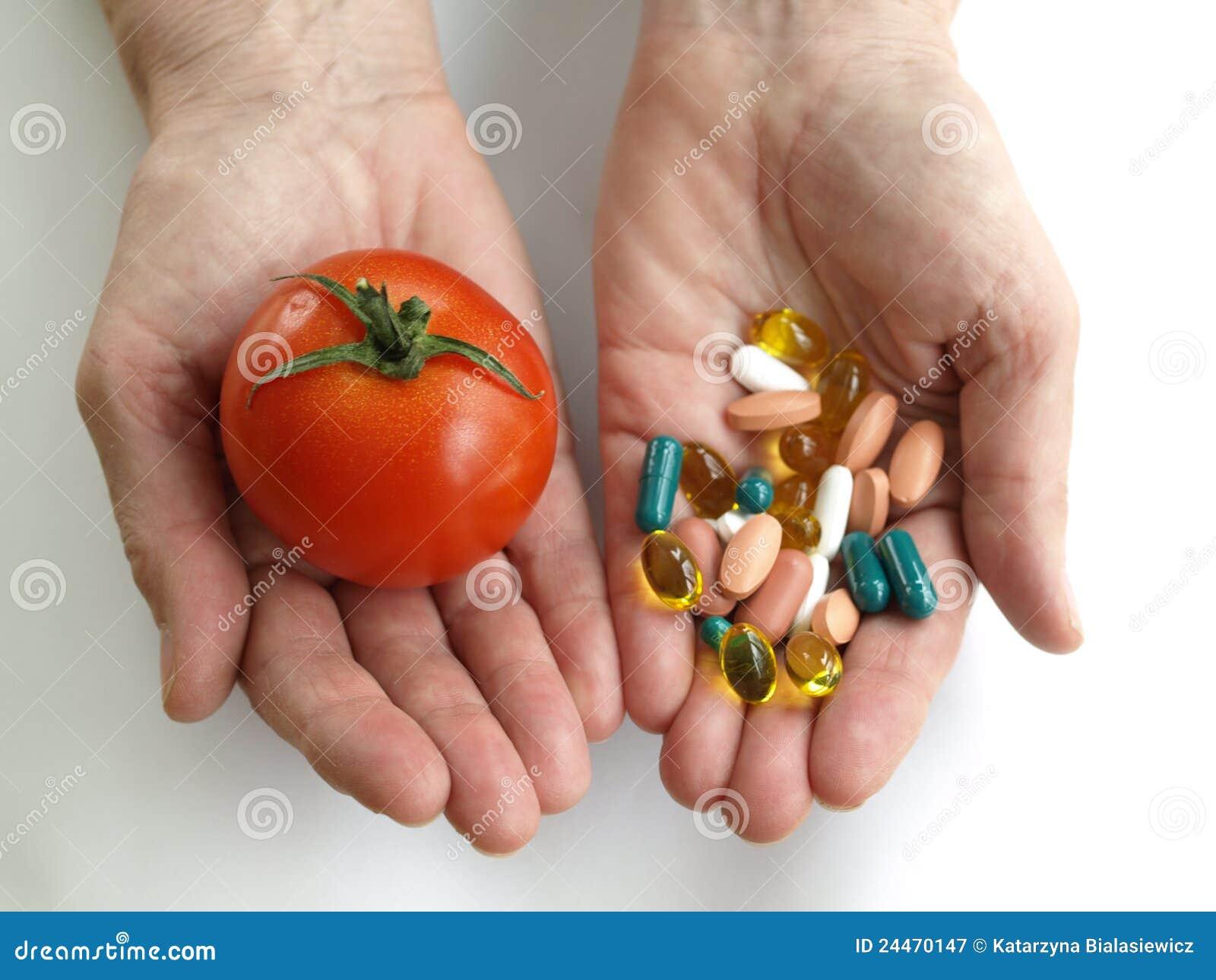 Tomato and handfull of pills