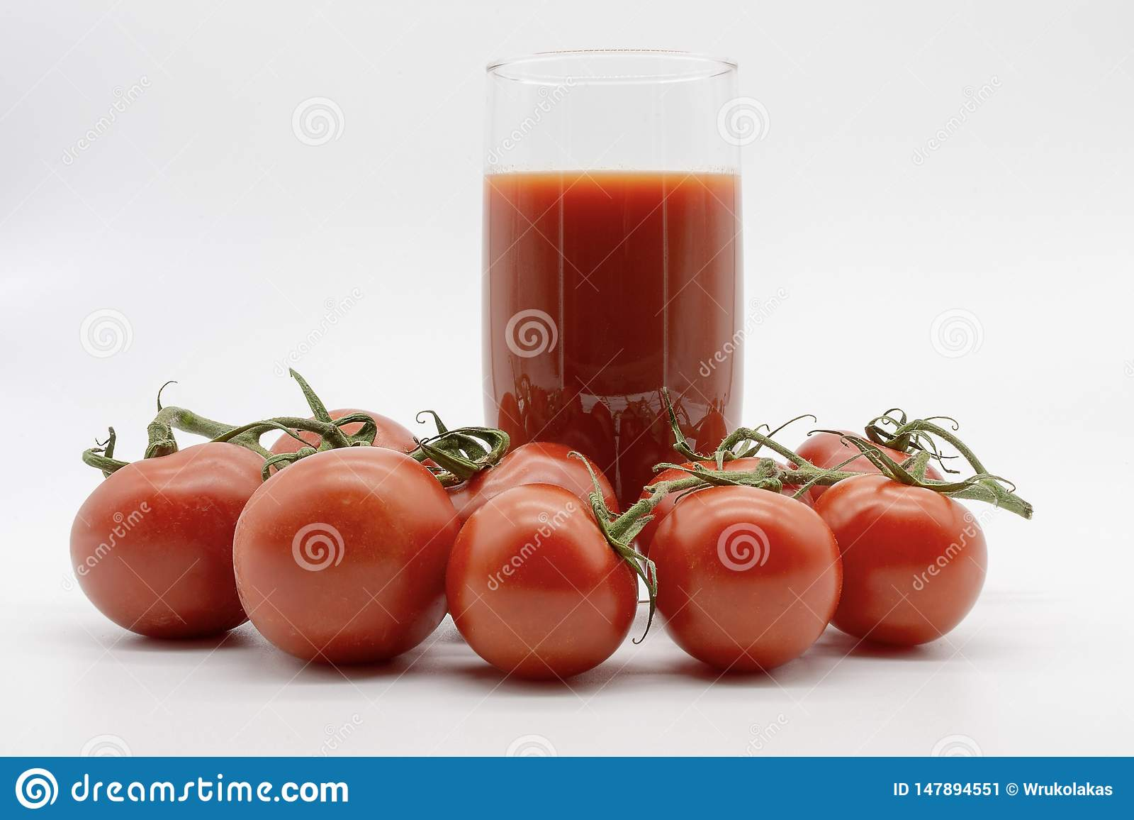 Delicious tomato juice and a hand full of fruits