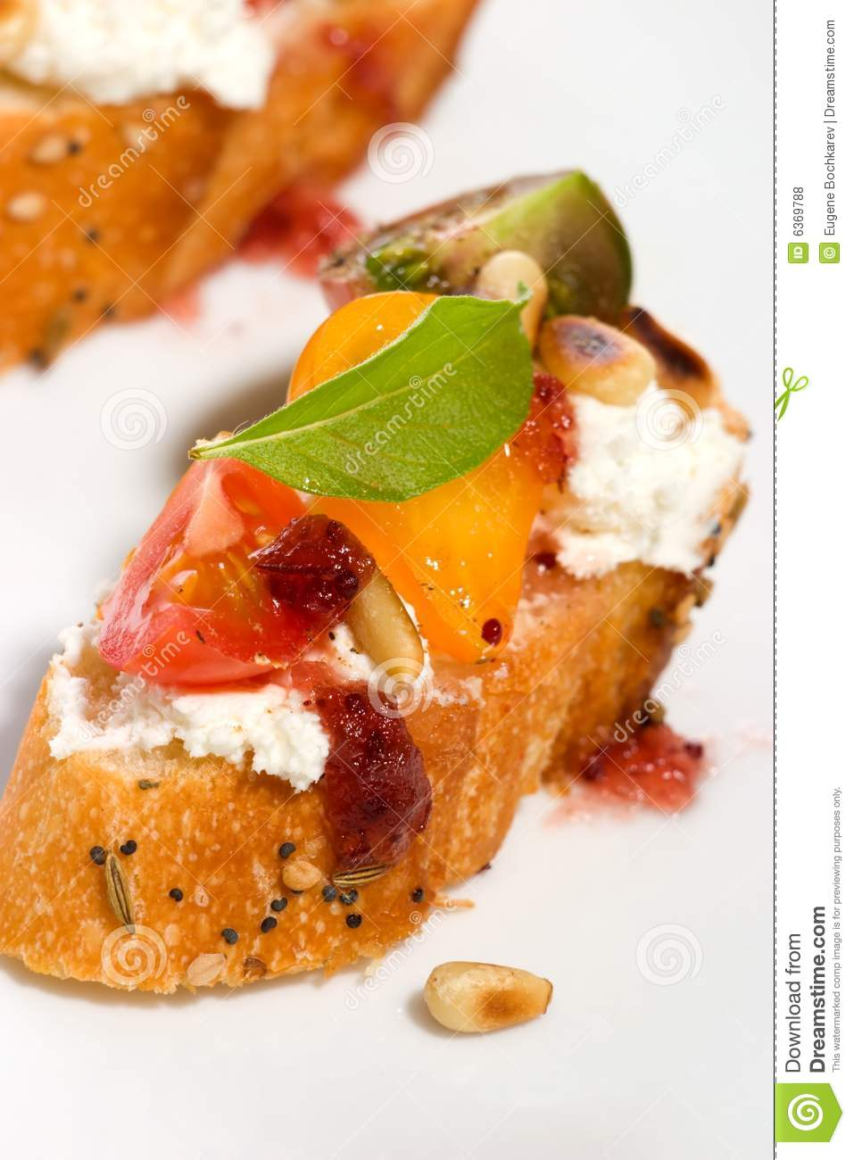 Tomatoes and cream cheese canapes royalty free stock for Cream cheese canape
