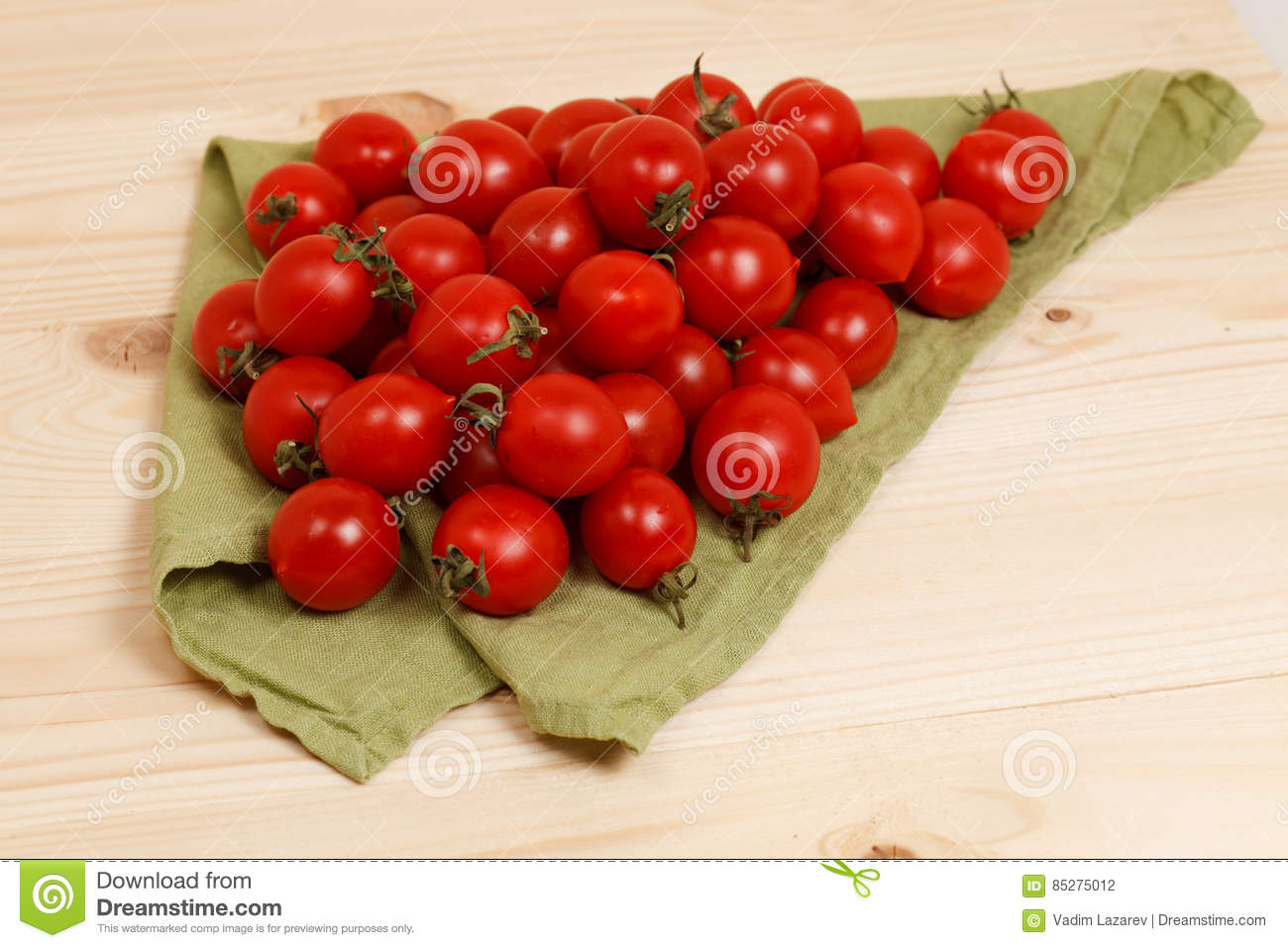 tomatoes on green fabric wooden background