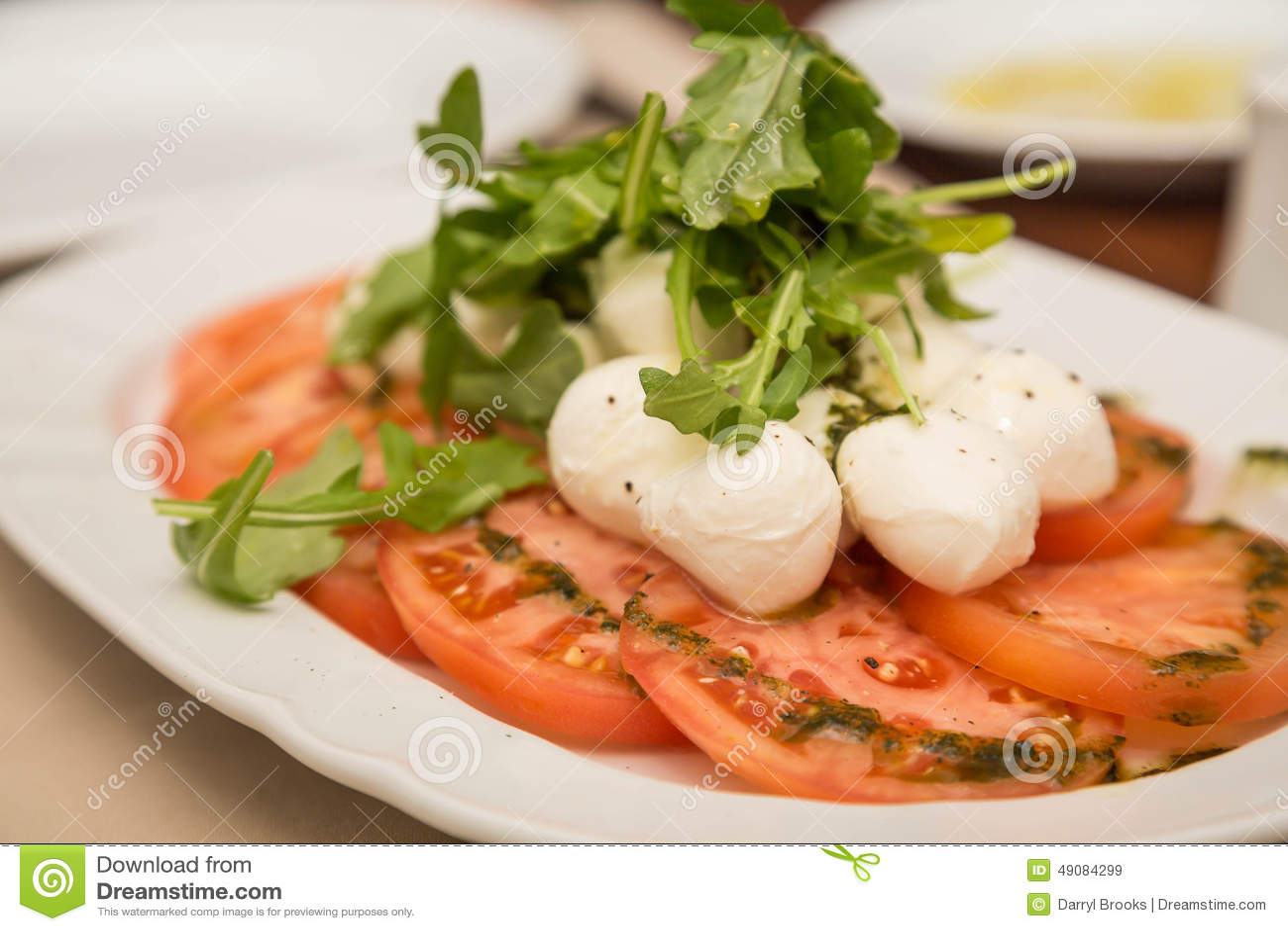 Tomatoes Mozzarella And Arugula Stock Photo - Image: 49084299