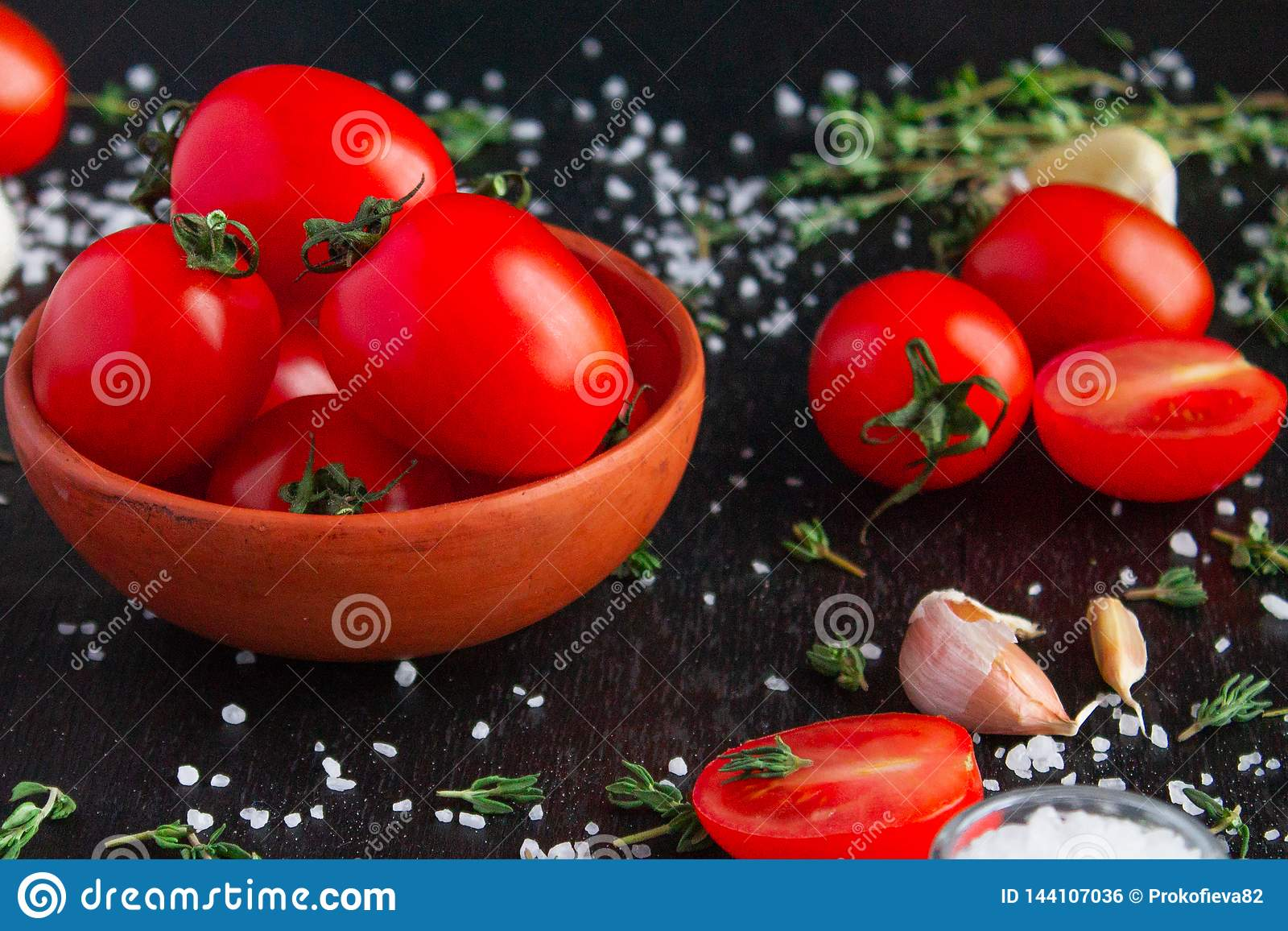 Tomatoes in a dish on a black background
