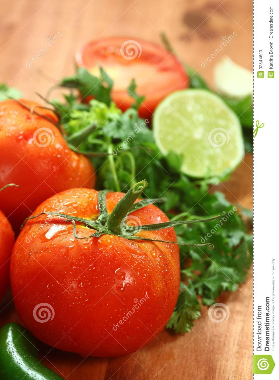 Tomatoes on a rustic wood plank stock photos image