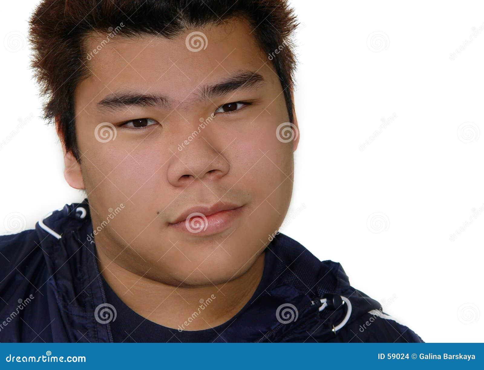 Tonårs- asiatisk pojke