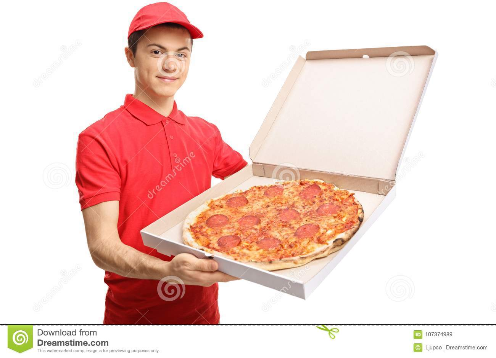 Tonårs- pizzaleveranspojke som visar en pizza inom en ask