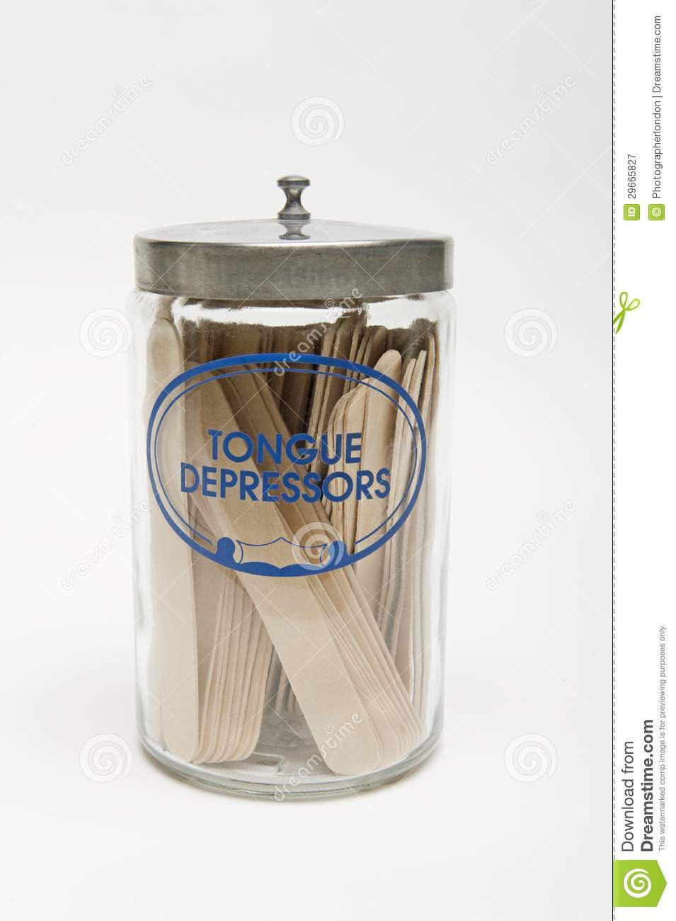 Tongue Depressors In A Glass Bottle