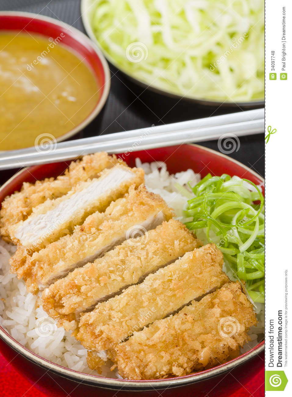 Tonkatsu - Japanese breaded, deep-fried pork cutlet on top of boiled ...