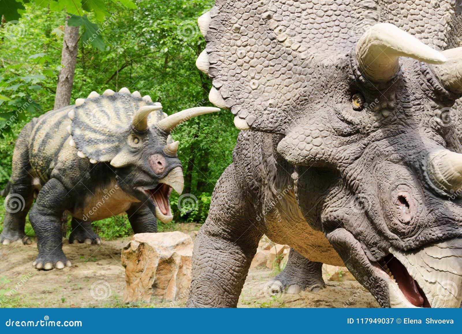 too dinosaurs model triceratops in dinosaur park editorial