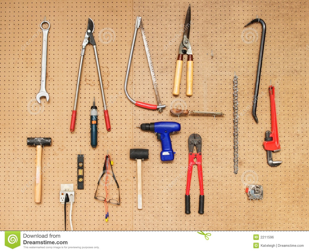 Various tools hanging on a pegboard wall