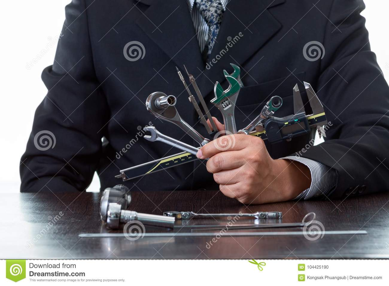 Tools and mechanical engineer working by holding many kind of tooling